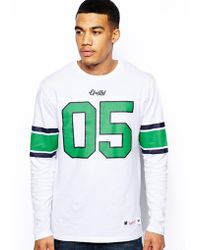 Undefeated Blitz Long Sleeve Football Top - Lyst