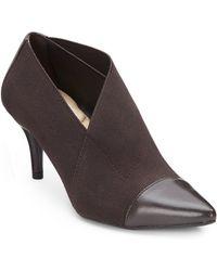 Bandolino Isannah Asymmetrical Ankle Boots - Lyst