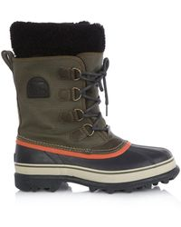 Sorel Caribou Canvas and Rubber Boots - Lyst