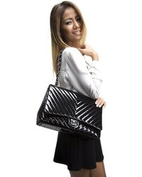 Chanel Pre-owned Patent Leather Chevron Maxi Flap Bag - Lyst