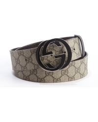 Gucci Brown Logo Embossed Rubberized Leather Gg Buckle Belt - Lyst