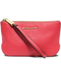 MICHAEL Michael Kors Large Leather Wristlet red - Lyst