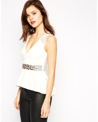 Asos Peplum Top With Embellished Trim And Lace Back - Lyst