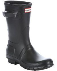 Hunter Black Rubber Slip-On Mid-Calf Rain Boots - Lyst