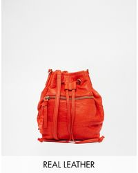 Oasis Leather Dixie Drawstring Duffle Bag in Orange - Lyst