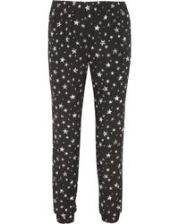 Tibi Star Fields Printed Crepe Track Pants - Lyst