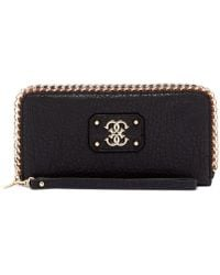 Guess Deputy Large Zip Around Wallet - Lyst