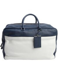 Prada Navy Blue and White Colorblocked On One Side Leather Travel Bag - Lyst