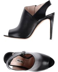 Miu Miu Black Sandals - Lyst