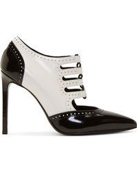 Saint Laurent Black and White Leather Wingtip Paris Stilettos - Lyst