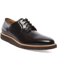 Common Projects Derby Shine black - Lyst