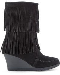 Minnetonka Black Fringe Wedge Boots - Lyst