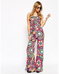 672148becb8 Jaded London - Lace Front Jumpsuit With Wide Leg In All Over Festival Bead  Print -