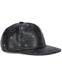 299913daf4f MCM - Visetos Black Studded Cap - Lyst