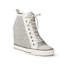 DKNY Grommet Perforated Wedge Sneaker - Lyst