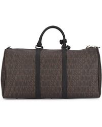 Moschino - Brown Printed Leather Holdall - Lyst