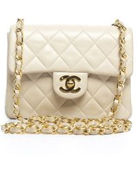 Chanel Pre-owned Ivory Mini Flap Bag - Lyst