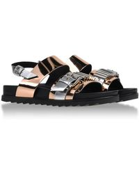McQ by Alexander McQueen Sandals gold - Lyst