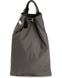 Jil Sander Buckle Slouchy Backpack - Lyst