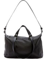 Costume National Black Pebbled Leather Duffle Bag - Lyst