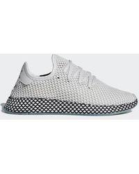 pretty nice dffe7 3ffd6 adidas - Deerupt Runner Shoes - Lyst