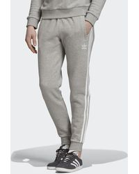 fa75b62ad adidas Essentials 3-stripes Jogger Pants in Black for Men - Lyst