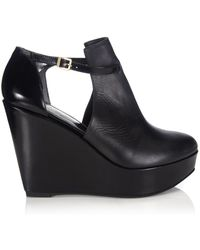 Robert Clergerie Black Leather Wedge Filano Boots - Lyst