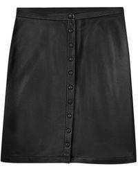 agnès b. - Black Leather Snap Skirt - Lyst