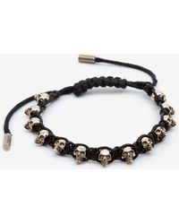 Alexander McQueen - Armband mit mehreren Skulls - Lyst
