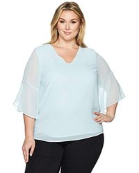 0aa3e8f13f1 Lyst - Calvin Klein Plus Size High-low Printed V-neck Top in Blue