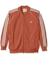 261467b29cab Lyst - adidas Originals Essentials Superstar Track Jacket in Purple ...