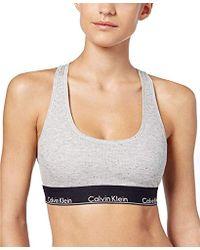 4929dd116d Lyst - Calvin Klein Carousel Logo Bralette in Black - Save 25%