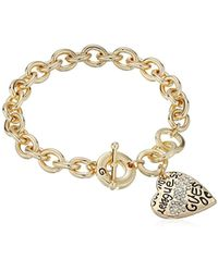 "Guess - ""basic Graffiti Logo Heart Toggle Charm Bracelet - Lyst"