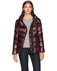 2476109bfeb Calvin Klein - Pearlized Asymmetrical Zipper Down Jacket - Lyst