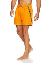 4367bab4e2d98 Calvin Klein Yellow Logo Tape Swim Shorts in Yellow for Men - Lyst