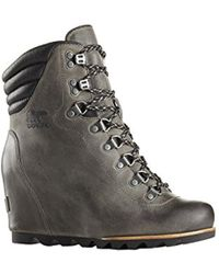 d4301f50835 Lyst - Sorel Conquest Holiday Wedge Leather Ankle Boots in Brown