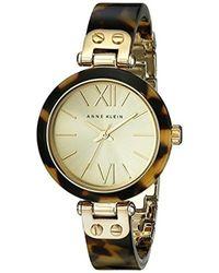 Anne Klein - 109652chto Gold-tone Tortoise Shell Plastic Bracelet Watch - Lyst