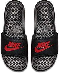 ea9a1cd54f4 Lyst - Nike Enassi Just Do It Slides in Black for Men