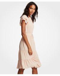 Ann Taylor - Petite Smocked Tie Waist Ruffle Dress - Lyst