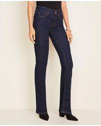 Ann Taylor - Petite Sculpting Pockets Boot Cut Jeans In Dark Rinse Wash - Lyst