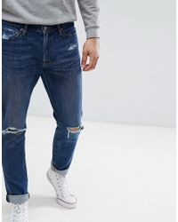 Abercrombie & Fitch - Stretch Super Slim Distressed Jeans In Mid Wash - Lyst