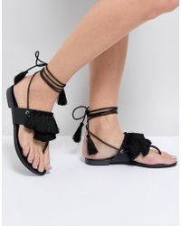 Truffle Collection - Fringe Tie Up Flat Sandal - Lyst
