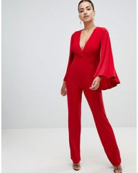 Club L - Cape V Plunge Wrap Jumpsuit - Lyst