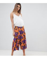 ASOS - Asos Design Maternity Low Rise Bump Band Wide Leg Culottes With Flowing Hem In Orange Floral Print - Lyst