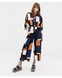 Monki - Drawstring Lipeyes Print Cropped Wide Leg Jumpsuit - Lyst