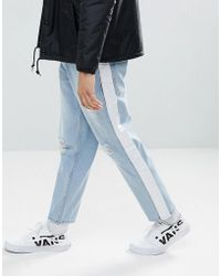 ASOS - Asos Skater Jeans In Light Wash With Abrasions And Side Stripe - Lyst