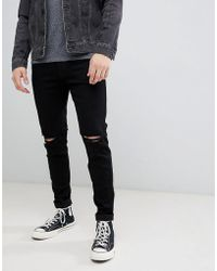 Hollister - Destroy Super Skinny Jeans In Black - Lyst