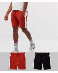ASOS - Pack de 2 pantalones cortos ajustados de punto con raya lateral en negro y rojo de - Lyst
