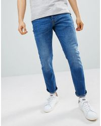 River Island - Slim Jeans In Mid Wash Blue - Lyst