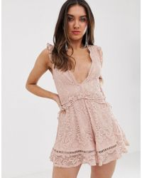Love Triangle - Plunge Front Eyelash Lace Romper With Flippy Hem In Soft Mink - Lyst